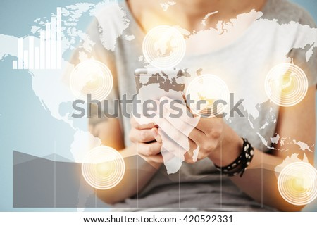 Worldwide communication interface. Woman's hands holding mobile phone. Student girl messaging with her friends during classes at university. Female in gray T-shirt reading text message on cell phone  - stock photo