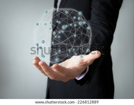 worldwide network concept: tied structure over businessman han - stock photo