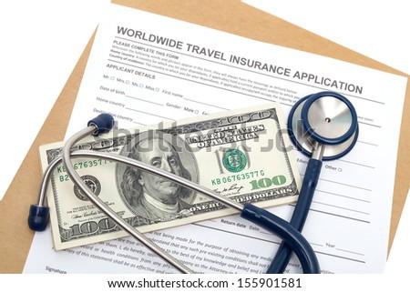 Worldwide travel medical insurance application with stethoscope on money - stock photo