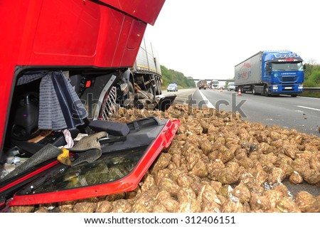 Worms, Germany - September 16, 2009 - Truck crash on german highway A61 near Worms, destroyed by its loaded turnips, no people have been hurt. - stock photo