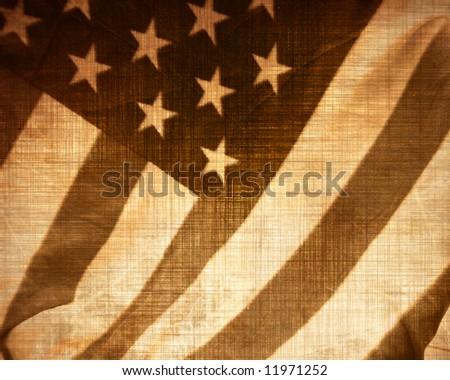 worn american flag waving in the wind - stock photo