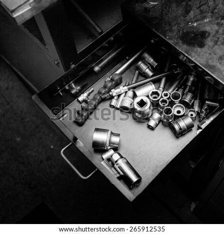 Worn and dirty wrenches in a workshop