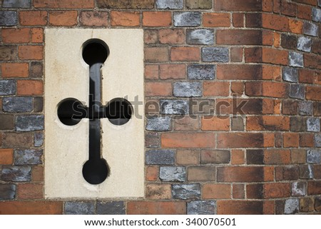 Worn and weathered brick wall with ventilation at Hampton Court in London England. - stock photo