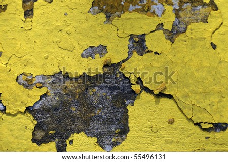 Worn and weathered crusted chipped paint on textured cement - stock photo
