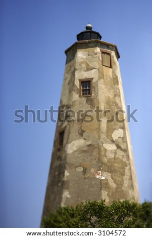 Worn and weathered lighthouse on Bald Head Island, North Carolina. - stock photo