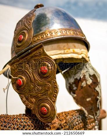 Worn antique Roman helmet - stock photo