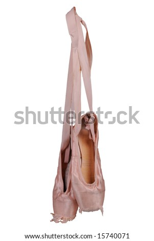 Worn ballet toe shoes isolated over a white background
