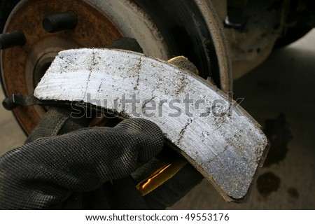 Worn brake pad - stock photo