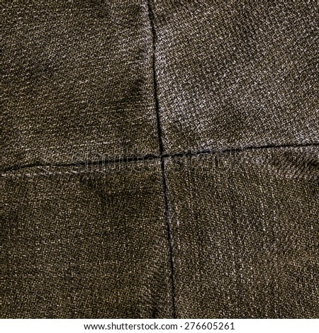 worn brown jeans texture,seams in shape of the cross - stock photo