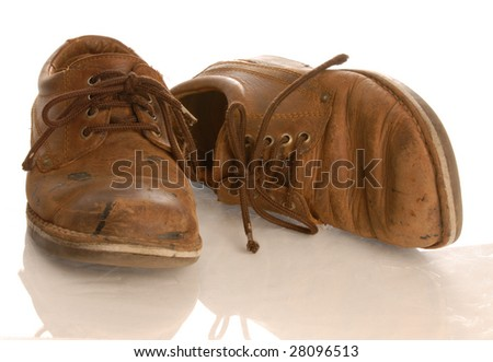 worn brown leather shoes isolated on white background - stock photo