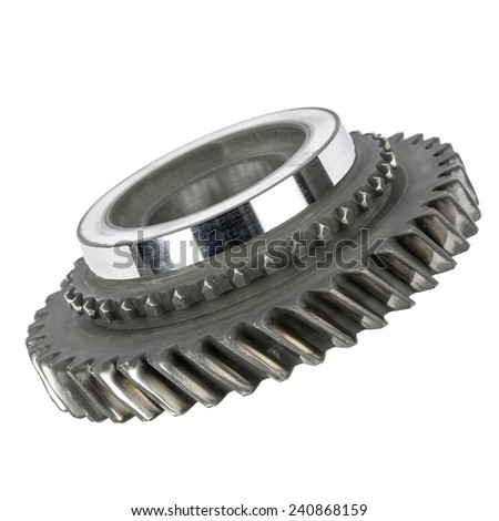 Worn cog wheel removed from the main shaft of gearbox - stock photo