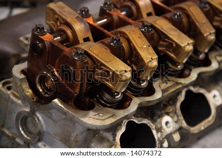 Worn dirty gasoline engine on the bench being repaired - stock photo
