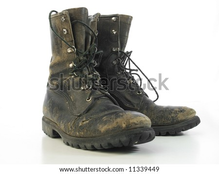 Worn old combat boots - stock photo