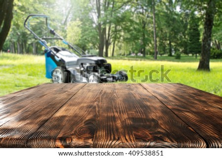 worn old table and garden  - stock photo