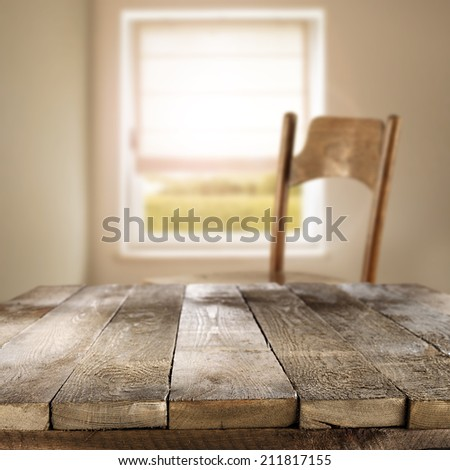 worn old table chair space and window with sunlight  - stock photo