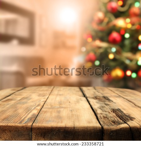 worn old table of wood and xmas tree space  - stock photo