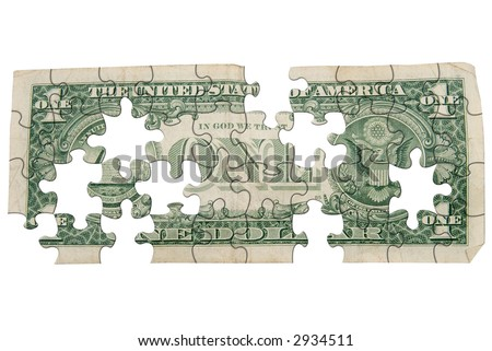 Worn one dollar bill backside cut out into puzzle shapes isolated over white - stock photo