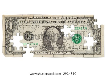 Worn one dollar bill cut out into puzzle shapes isolated over white - stock photo