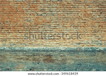 Worn orange and cyan blue brick wall texture background. Faded. Vintage effect. - stock photo