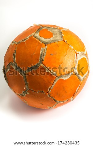 worn orange soccer ball - stock photo