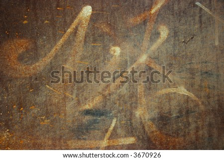 Worn out graffiti on rusted metal - stock photo
