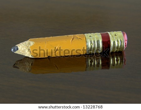 Worn out pencil with reflection - stock photo
