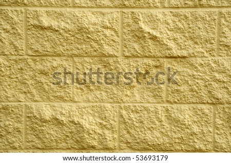 Worn out textured cement gray wall with some white spray paint on it and yellow decay on the bottom. - stock photo