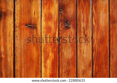 Worn out varnished wooden fence texture - stock photo