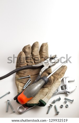 Worn out work glove and some tools. Add your text - stock photo