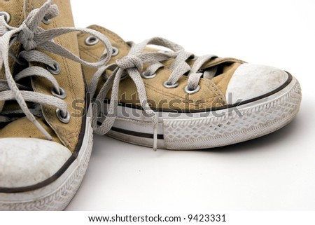 Worn Pair of Sneakers - stock photo