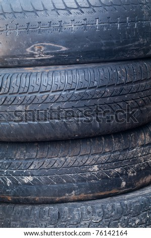 Worn tires stacked on each other. Background on the industrial theme. - stock photo