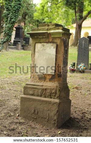 worn tombstone - stock photo