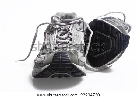 Worn trainers sneakers HDR effect style - stock photo