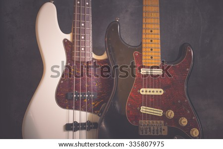 Worn vintage electric guitar and bass - stock photo