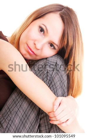 worried and afraid young woman sitting on chair. Isolated on white - stock photo