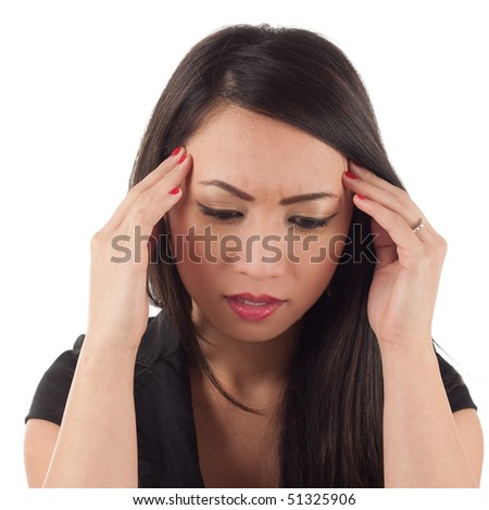 Worried attractive young asian woman with headache, head in hands - stock photo