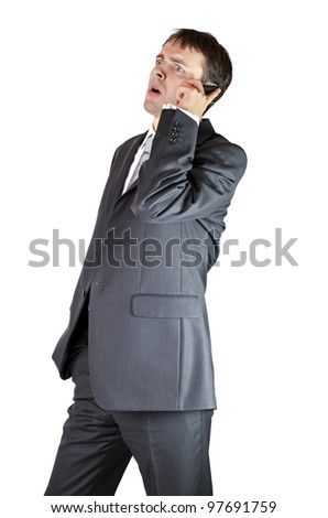 Worried businesman on a phone - stock photo