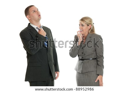 Worried business man and business woman isolated on a white background - stock photo