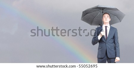 Worried business man on a rainy day - stock photo