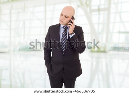 worried business man on the phone, at the office