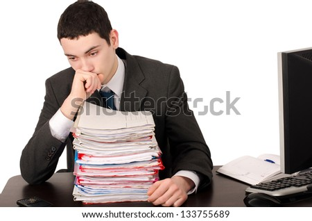 Worried business man with a lot of work. Unhappy worker with a big pile of files to work on. Isolated on white. - stock photo