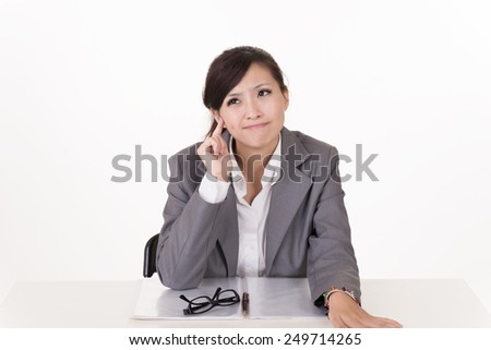 Worried business woman of Asian, closeup portrait on white background. - stock photo
