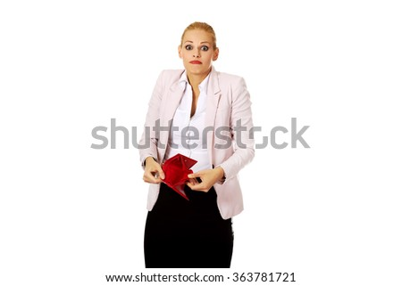Worried business woman shows her empty wallet - stock photo