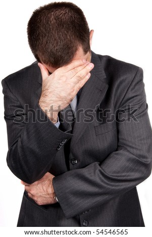 Worried businessman against white background - stock photo