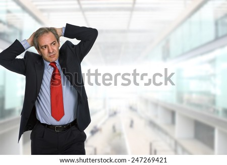 worried businessman at the office - stock photo