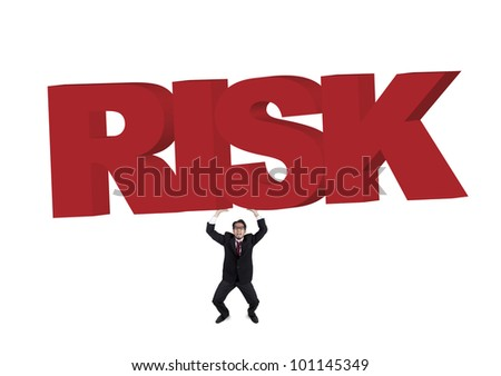Worried businessman carrying a huge and heavy sign of risk. Shot in studio isolated on white - stock photo
