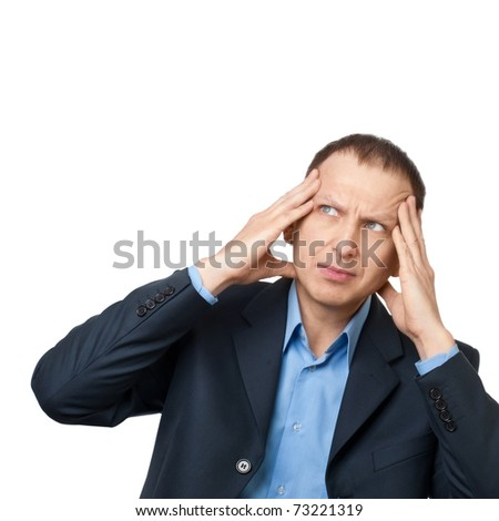 Worried businessman having a headache against white background - stock photo