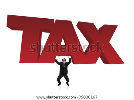 Worried businessman lifts a heavy tax sign - stock photo