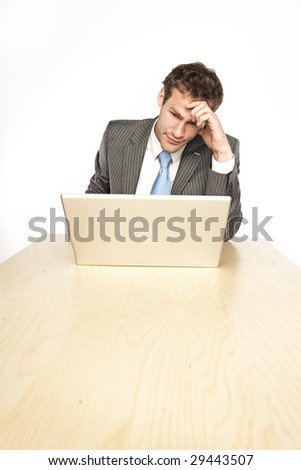 Worried businessman thinking deep and holding the head in his hand - isolated