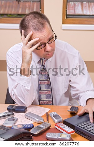 Worried businessman with computer - stock photo